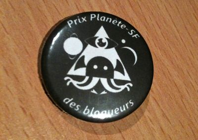 Utopiales 2013 - badge Planète-SF